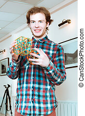 Young Man With Volumetric Models Of Geometric Solids