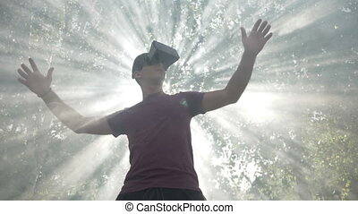 Young man with VR headset gadget immersed into virtual...