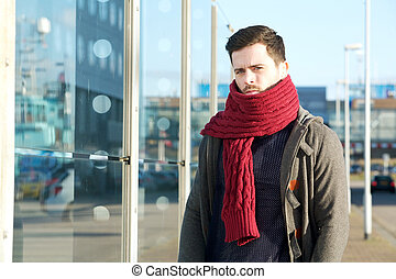 Young man with wool scarf and winter jacket
