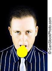 Young man with yellow bulb in his mouth