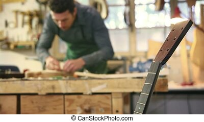 Young man working as artisan - Mid adult man at work as...