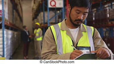 Young man working in a warehouse 4k