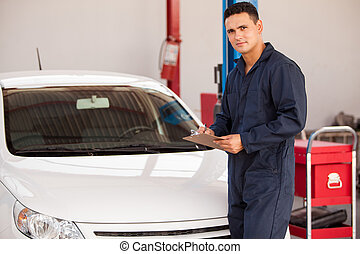 Young man working in an auto shop