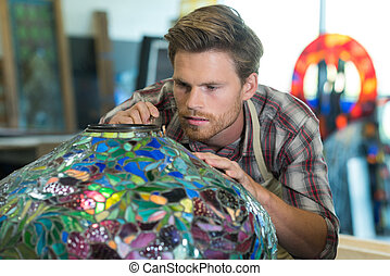 young man working on glass creation