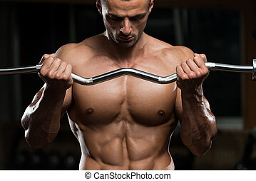 Young Man Working Out Biceps - Muscular Man Doing Heavy...