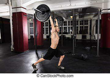 Young Man Working Out With Barbell