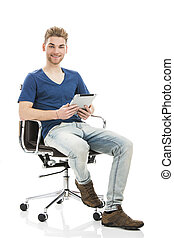 Young man working with a tablet