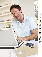 Young man working with laptop computer