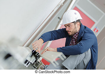 young man working with metal bars in construction site