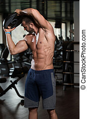 Young Man Workout Abdominal Muscles With Weights