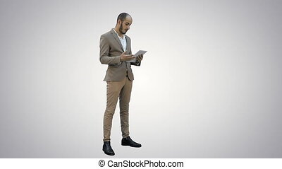 Young manager having video conference via tablet on white background.