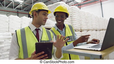Young managers interacting in a warehouse