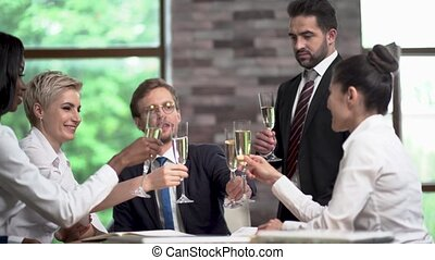 Young Managers of a Large Company are Drinking Champagne in the Office After Successful Negotiations.