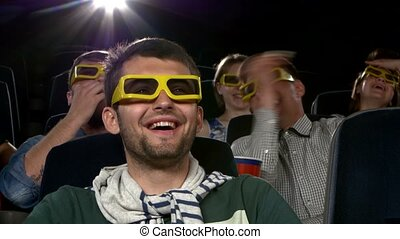 Young mans watching movie at cinema: 3D comedy. Close up -...