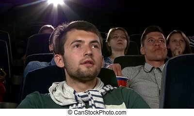 Young mans watching movie at cinema: thriller, Close up -...