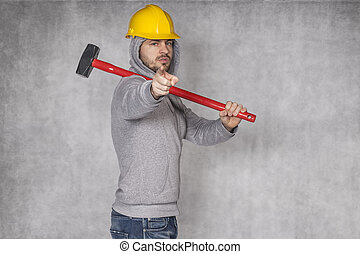 young manual worker pointing at you