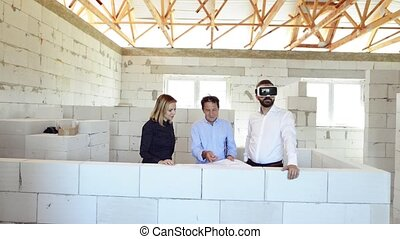 Young married couple at the construction site. - Young...