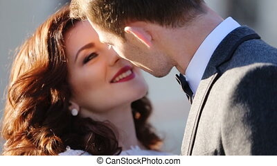 young married couple kissing shot in slow motion  close up