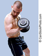 Young, masculine and fit man lifting dumbells 2