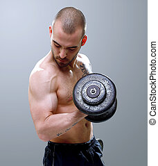 Young, masculine and fit man lifting dumbells