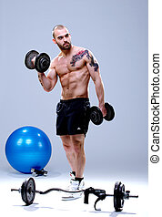 Young, masculine and fit man lifting weights 2