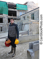 young mason on a construction site