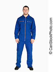 Young mechanic in boiler suit