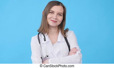 Medical doctor woman over blue background - young Medical...