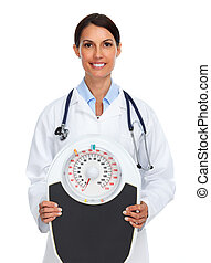 Young medical doctor woman with scales.