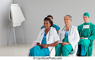 Medical team sitting at a conference