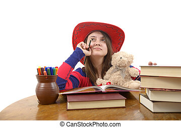 young meditative girl with red hat and her teddy bear at the table with books