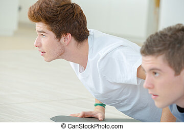 Young men in Cobra yoga position