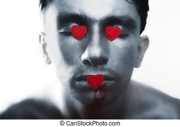 men in silver makeup with bruises and symbol of heart