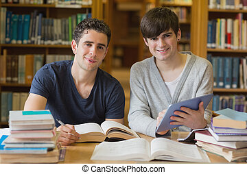 Young men looking up from studying