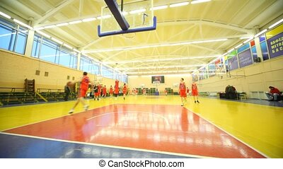 Young men play basketball in Russian State University of Physical Education