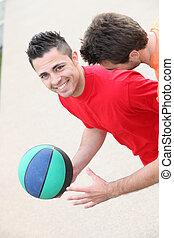 Young men playing handball