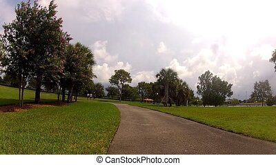 young men running in park.