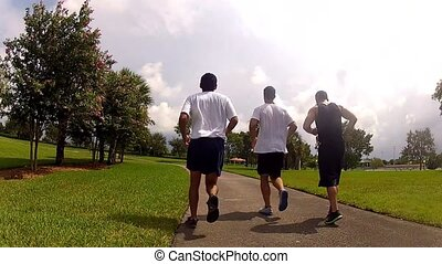 young men running in park.