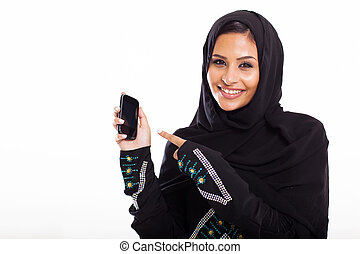 middle eastern woman pointing at smart phone