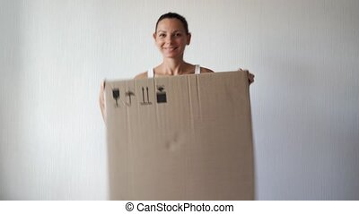 Young miillennial woman relocation with huge carton box. Online purchase, delivery person. High quality 4k footage