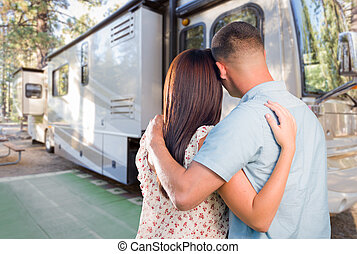 Young Military Couple Looking at New RV