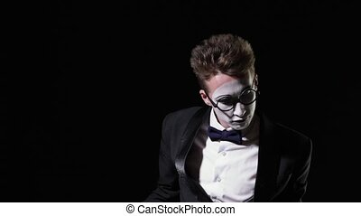mime man behind an invisible glass wall - Young mime man...