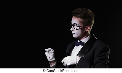 mime man in texudo opening an invisible glass window and...