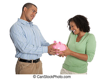 Young mischievous couple pulling a pink piggy bank against white background
