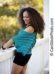 Young Mixed Black Woman Blue Top Outdoors