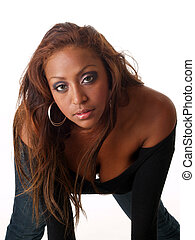 Young mixed black woman leaning over portrait