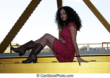 Young Mixed Black Woman Red Dress Sitting