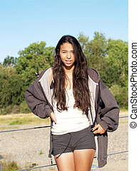 Young mixed brown girl outdoors in shorts
