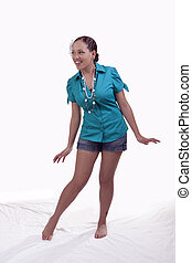 Young mixed ethnic woman standing shorts shirt