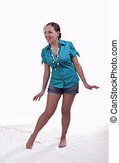Young mixed ethnic woman standing shorts shirt